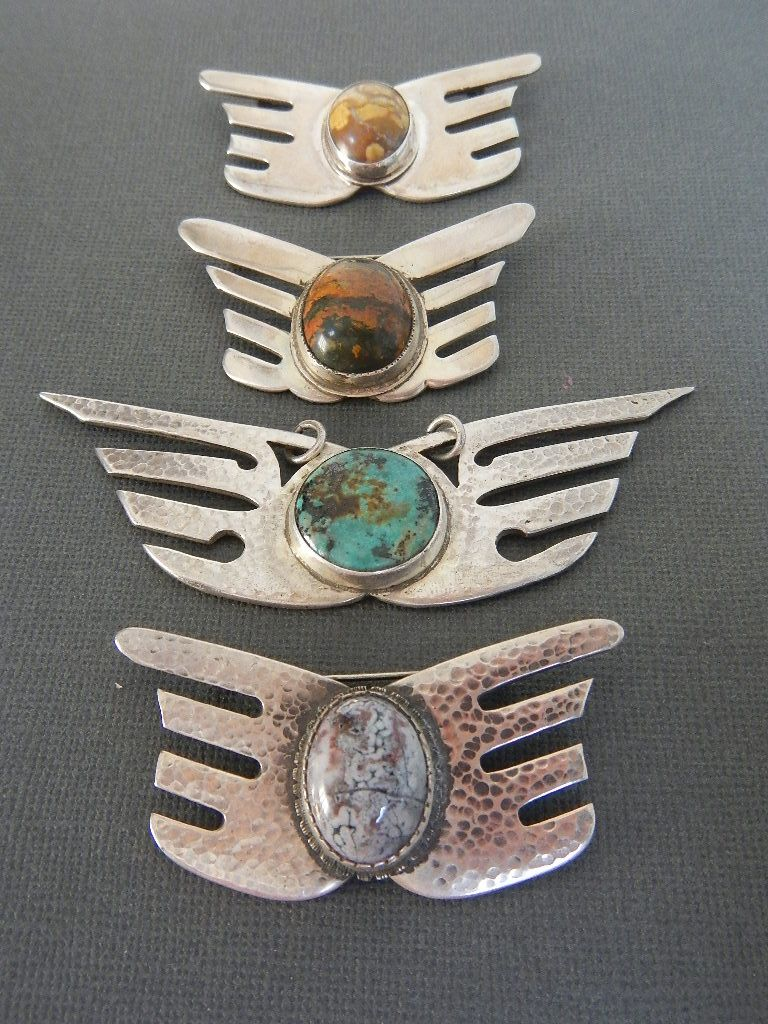 Sterling silverware fork wings with stones. 3 pins and a pendant.