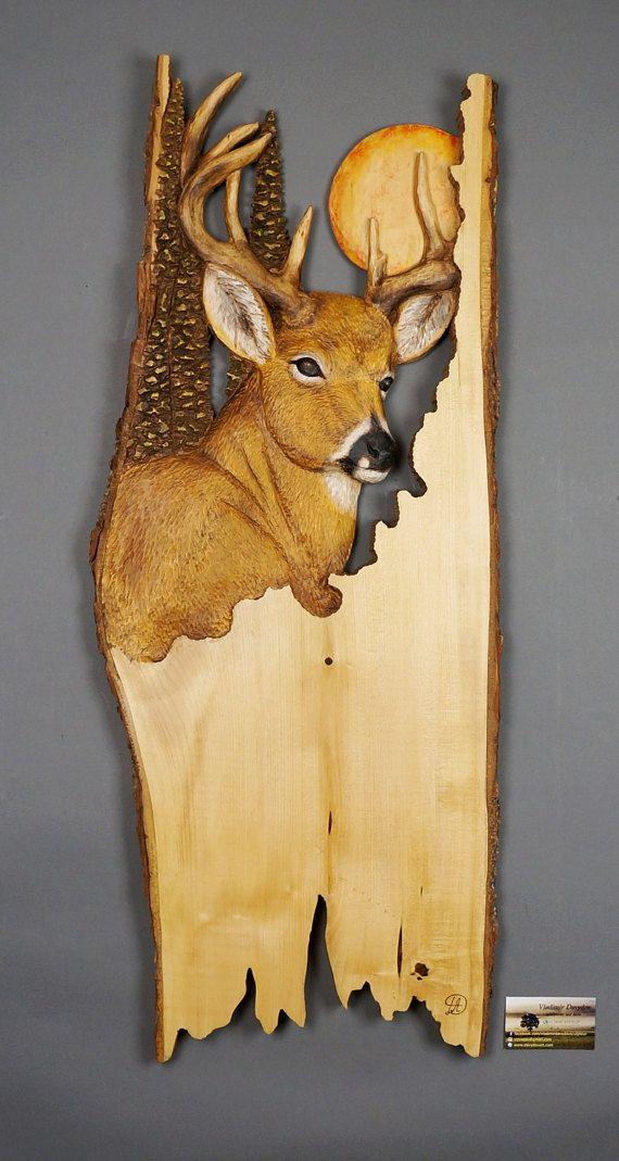 Deer carved on wood carving linden tree with bark