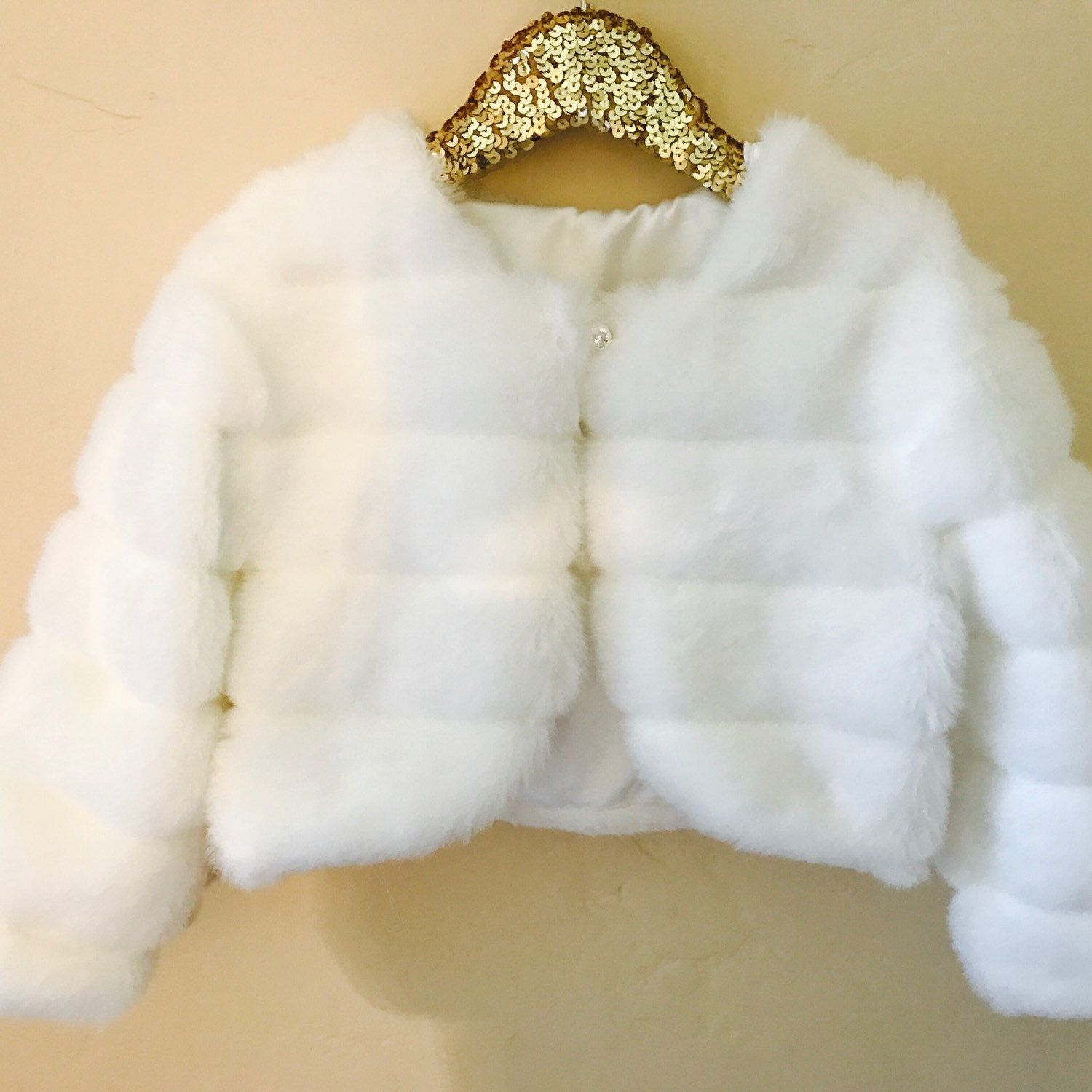 1b691db99f4c Our latest faux fur white bolero. Perfect for all your little angel s  special occasions.
