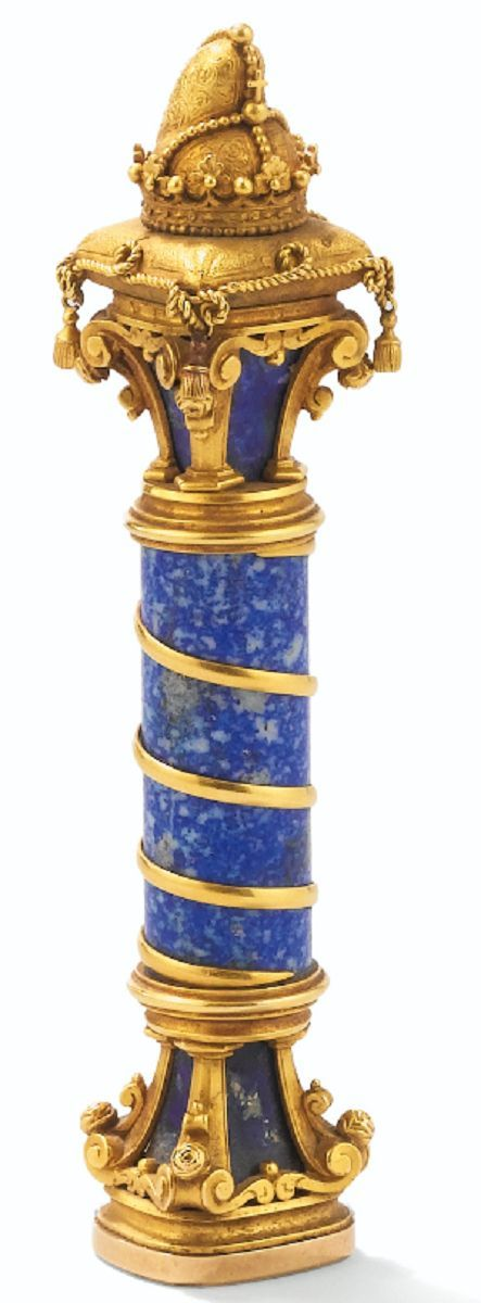 A GOLD-MOUNTED LAPIS LAZULI DESK SEAL, AUSTRIA, CIRCA 1876 formed as a column surmounted by a Venetian doge's corno ducale resting on a coronet and cushion, the matrix engraved with the arms of Counts Mocenigo and Princes Windisch-Graet.