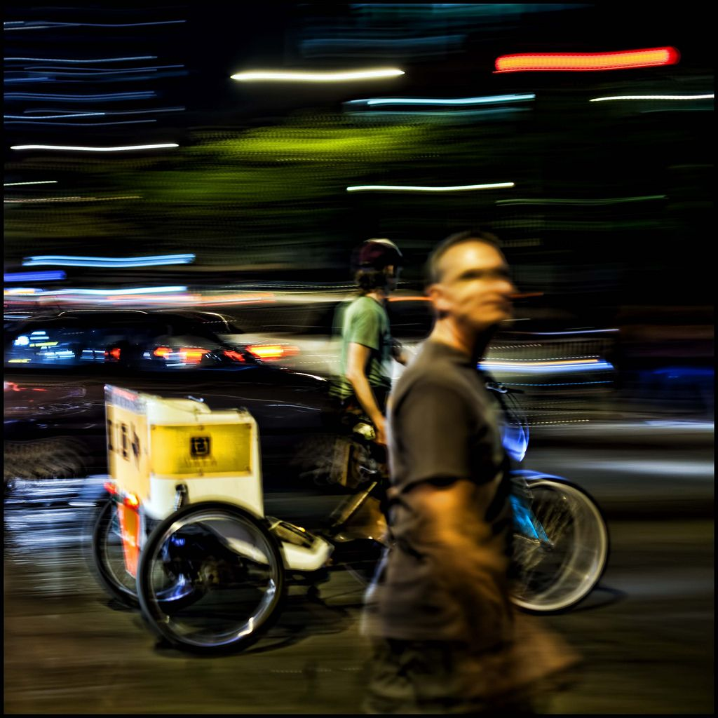Bike Taxi, panning shot, SXSW 6th and Congress, Austin, Texas