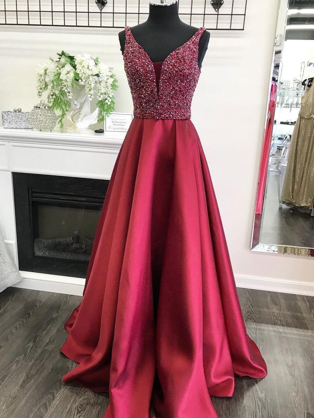 Dark red deep v neckline heavily beaded a line long evening prom