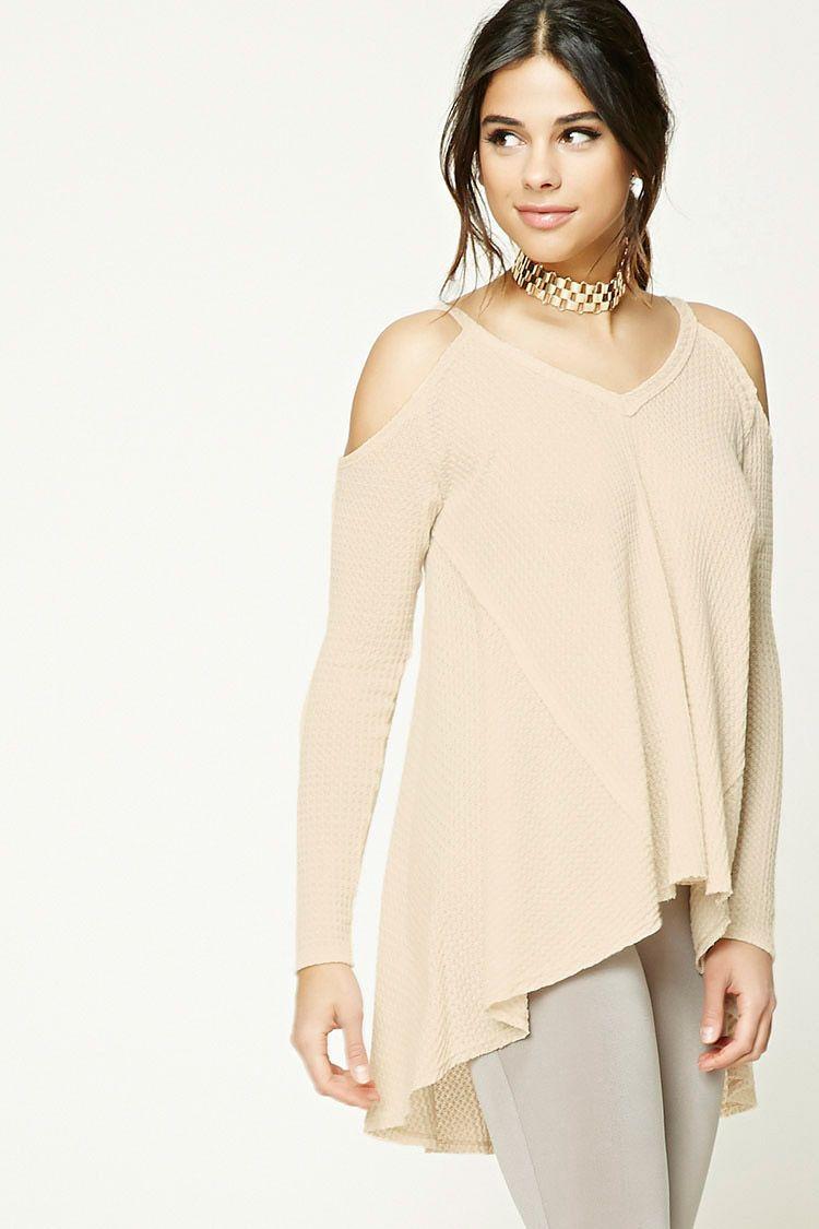 A honeycomb knit top featuring an open-shoulder design, a V-neckline ...