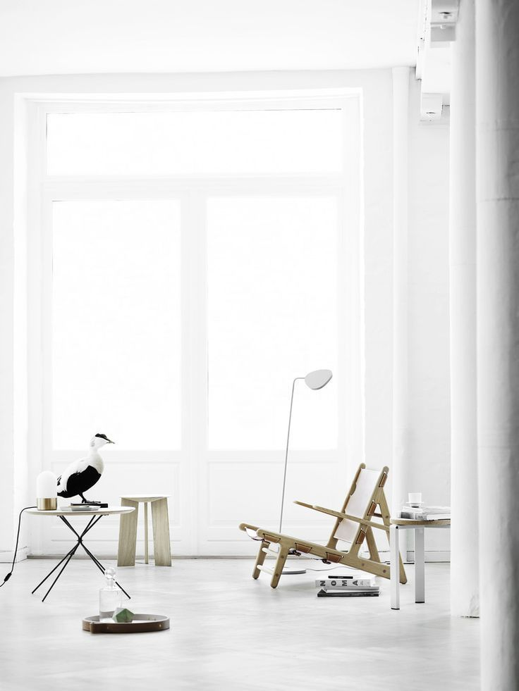 White Living Room With Large Windows And Pale Wood Designer Furniture