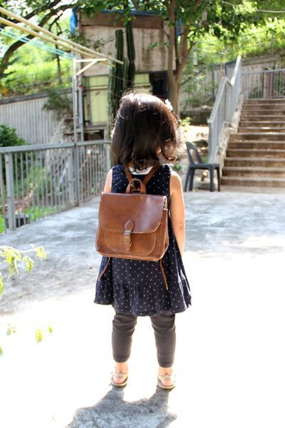 handmade leather backpack for kids, but this looks liek the style i want for when i have to ride my bike.  perfect for books, tablet and somet clothes maybe?