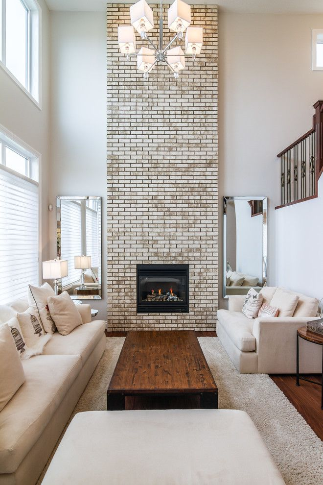 Whitewash Brick Fireplace Building With Black Frame Beige Sofas With Accent Pillows Soft Fu Red Brick Fireplaces Brick Fireplace Makeover White Brick Fireplace
