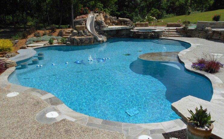 Free Form Pool With Bar Stools Jump Rock Raised Spa