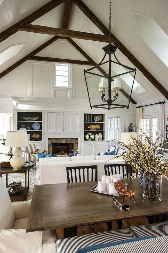 hgtv dream home 2015 dining room view into great room love the bookcase and doors to hide the tv over the fireplace