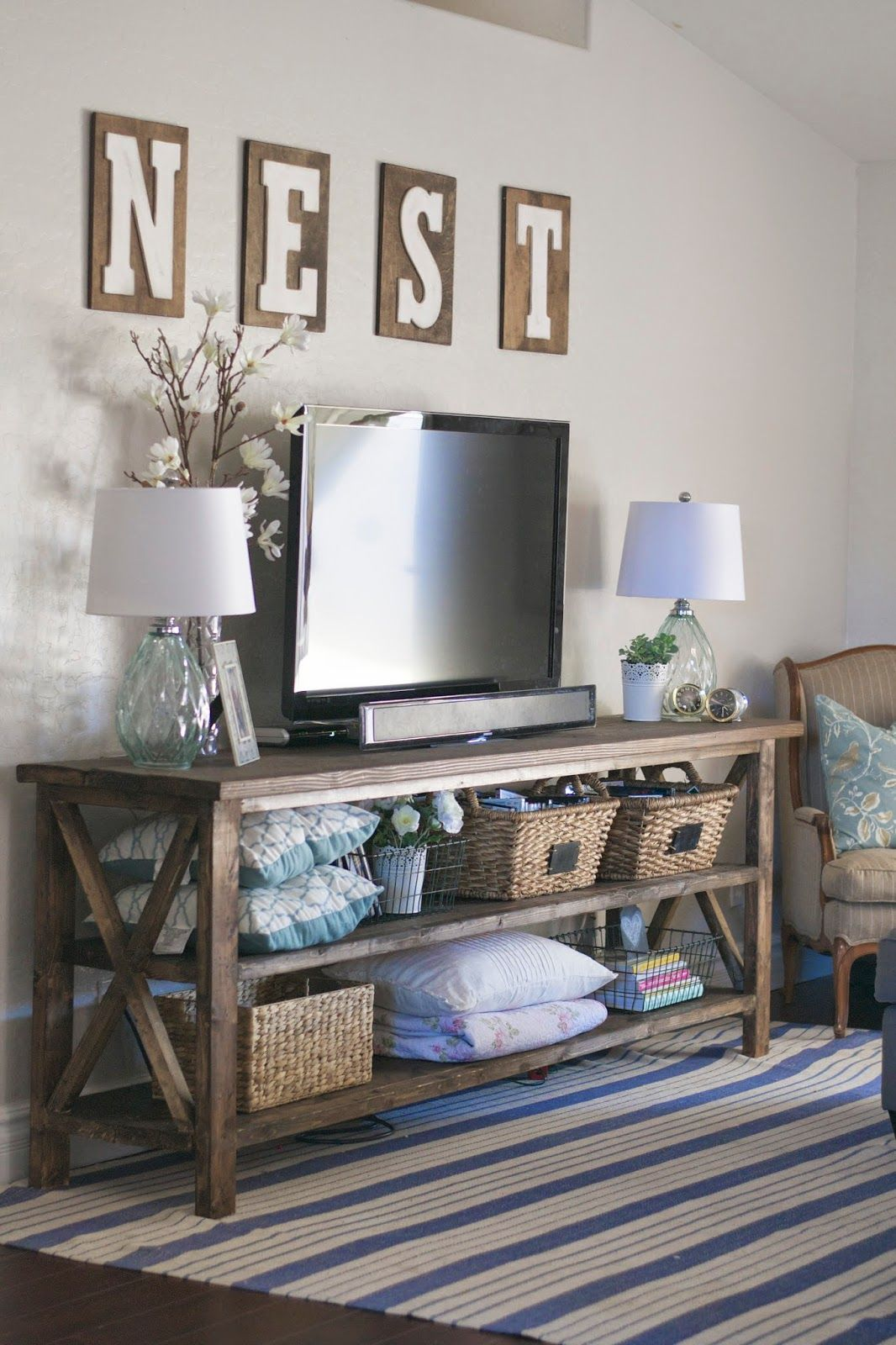 Beautiful living room decor love the console and nest for Living room 6 letters