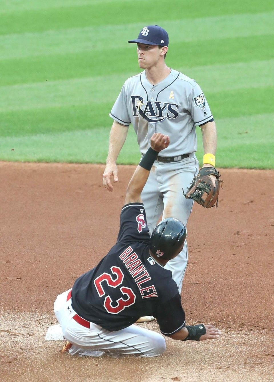 Cleveland Indians Michael Brantley Steals 2nd Base In The 1st As Tampa Bay Rays Joey Wendle Stands Behind At Cleveland Indians Michael Brantley Tampa Bay Rays