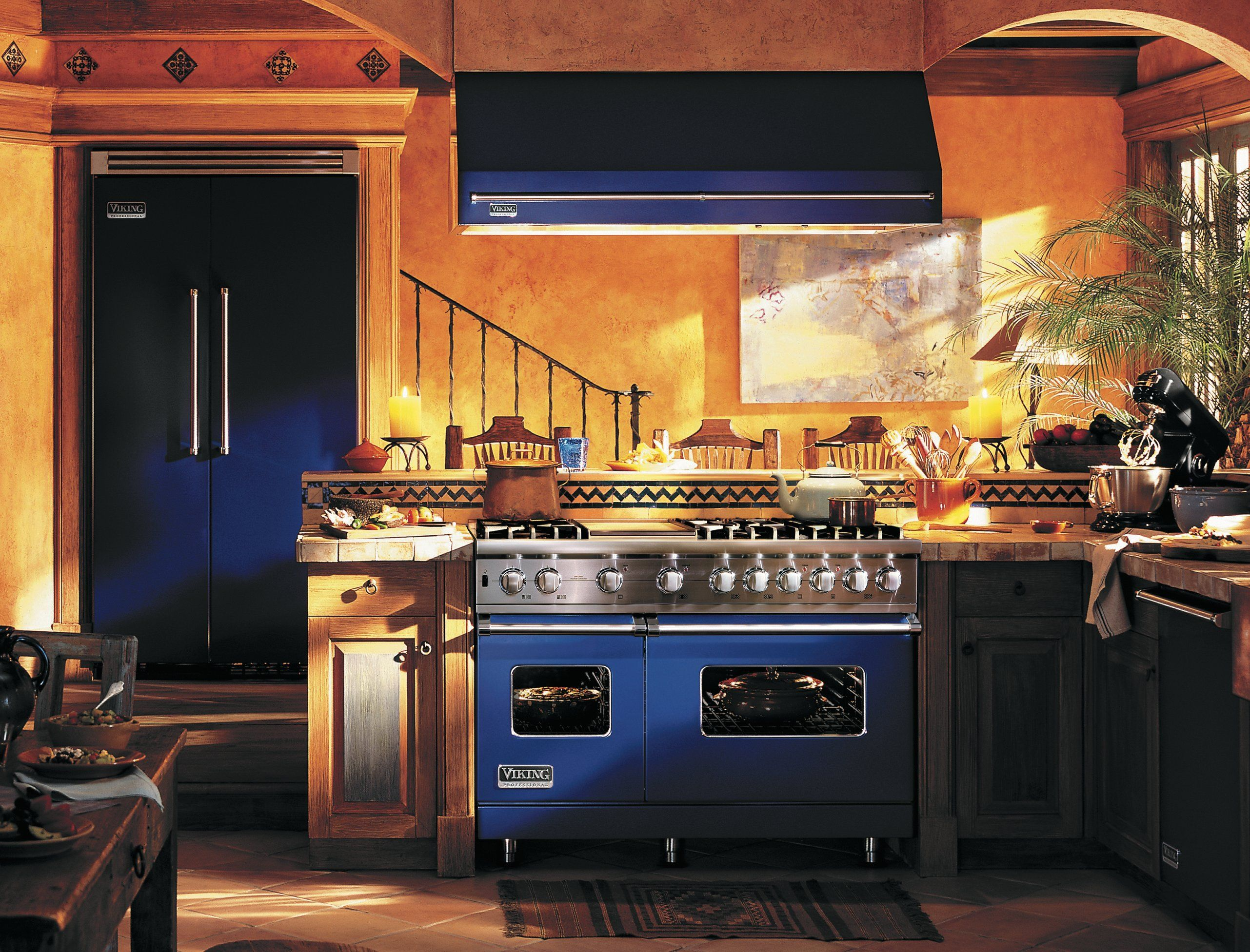 I love the bold blue stove with warm Mediterranean tones on the ...