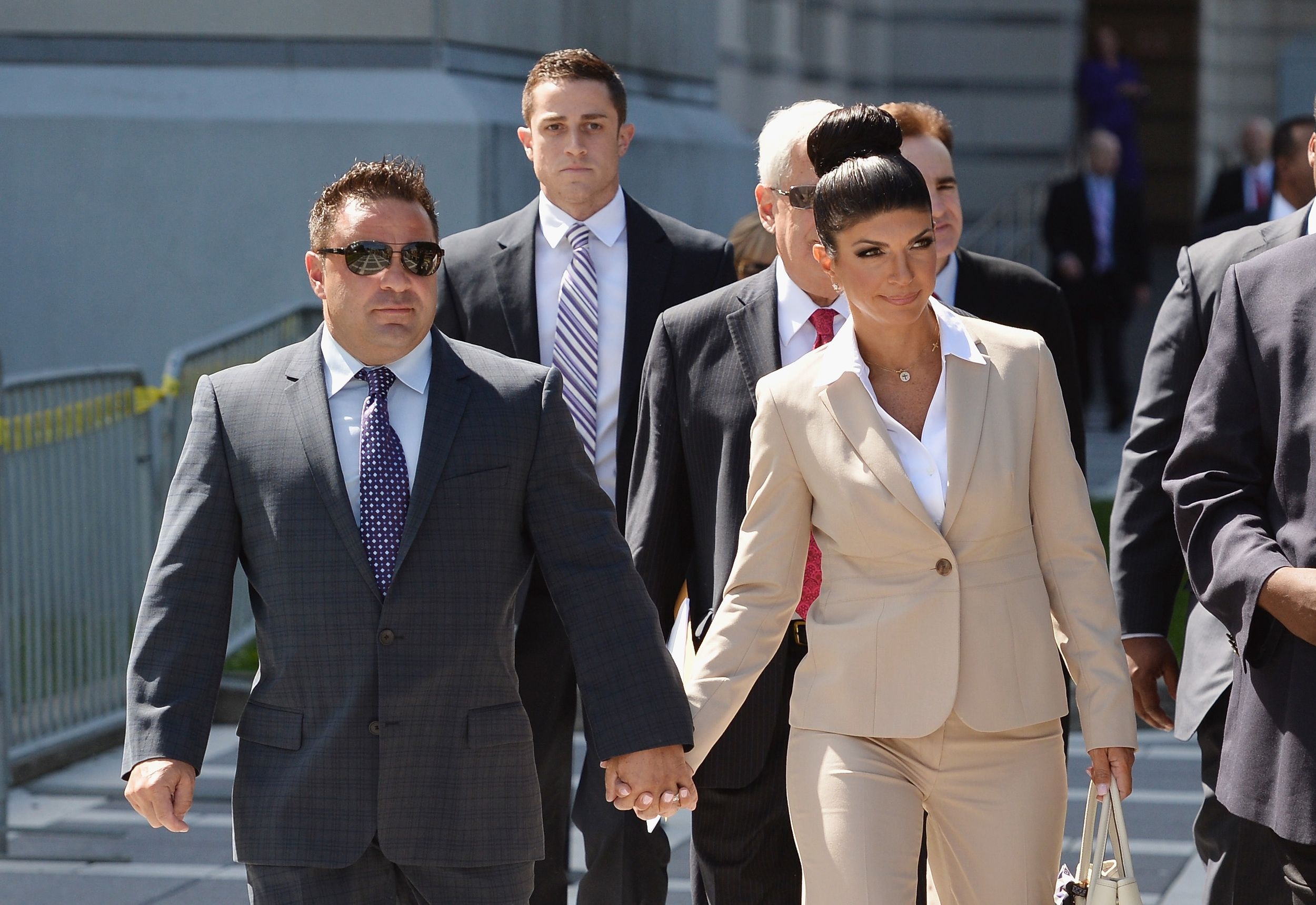 NEWARK, NJ - AUGUST 14:  Giuseppe 'Joe' Giudice (L) and wife Teresa Giudice leave court after facing charges of defrauding lenders, illegally obtaining mortgages and other loans as well as allegedly hiding assets and income during a bankruptcy case on August 14, 2013 in Newark, United States.  (Photo by Mike Coppola/Getty Images) via @AOL_Lifestyle Read more: http://m.aol.com/article/2016/07/14/teresa-giudice-storms-off-access-hollywood-live/21432298/?a_dgi=aolshare_pinterest#fullscreen