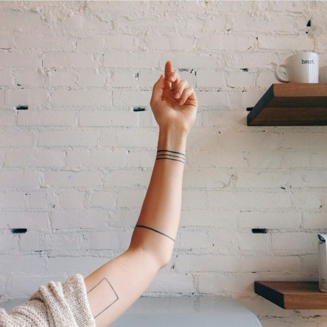 20 Minimalist Tattoos For The Design Lover Band Tattoo Designs Tattoos Band Tattoo