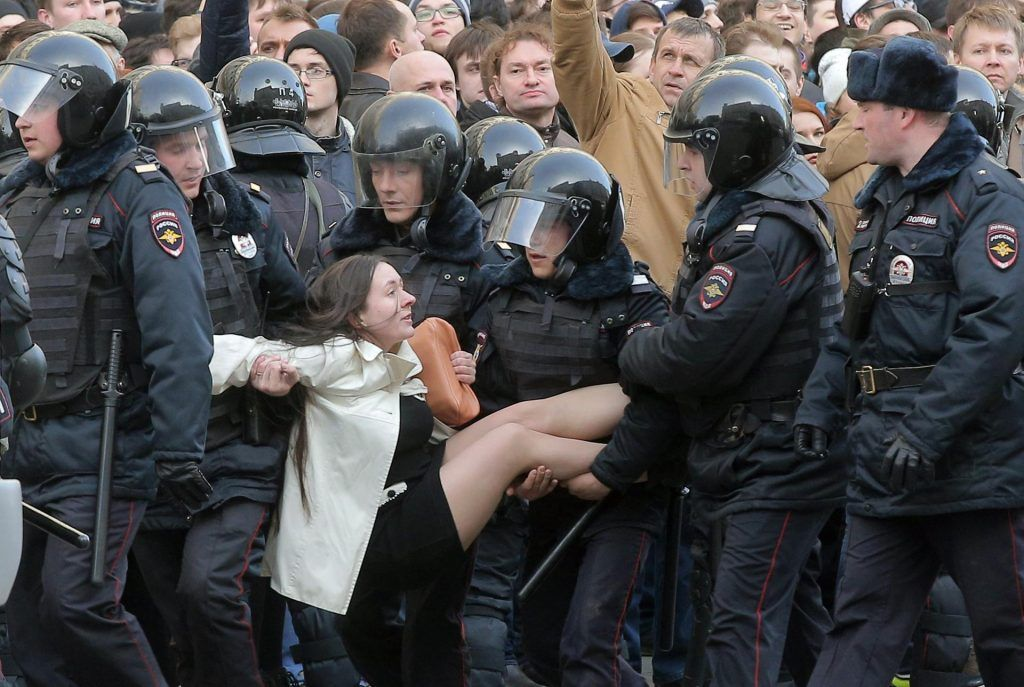 A woman was taken into custody during a protest in central Moscow, Russia. (Maxim Shipenkov / EPA) http://pow.photos/2017/international-pow-21-27-march/