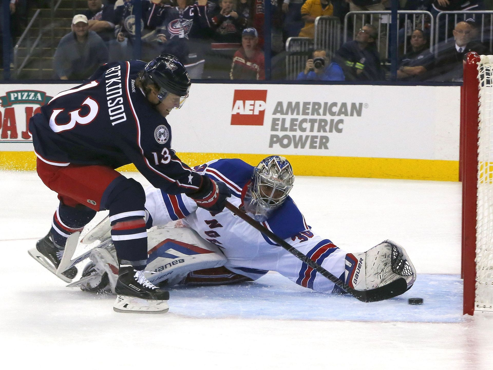 Blue Jackets wing Cam Atkinson (13) scores past Rangers goalie Henrik Lundqvist (30) during the second period in Columbus. Despite Atkinson's goal, New York won 4-2.  Russell LaBounty, USA TODAY Sports