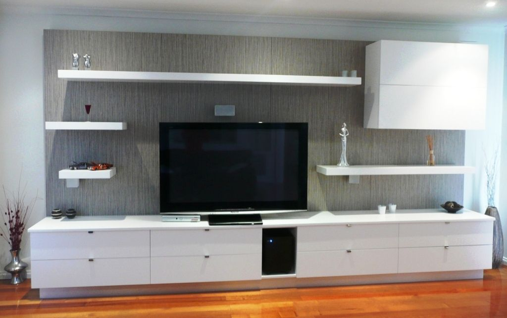 White Tv Media Wall Unit With Led Lighting Under The Shelves And A Laminate Feature Back Panel
