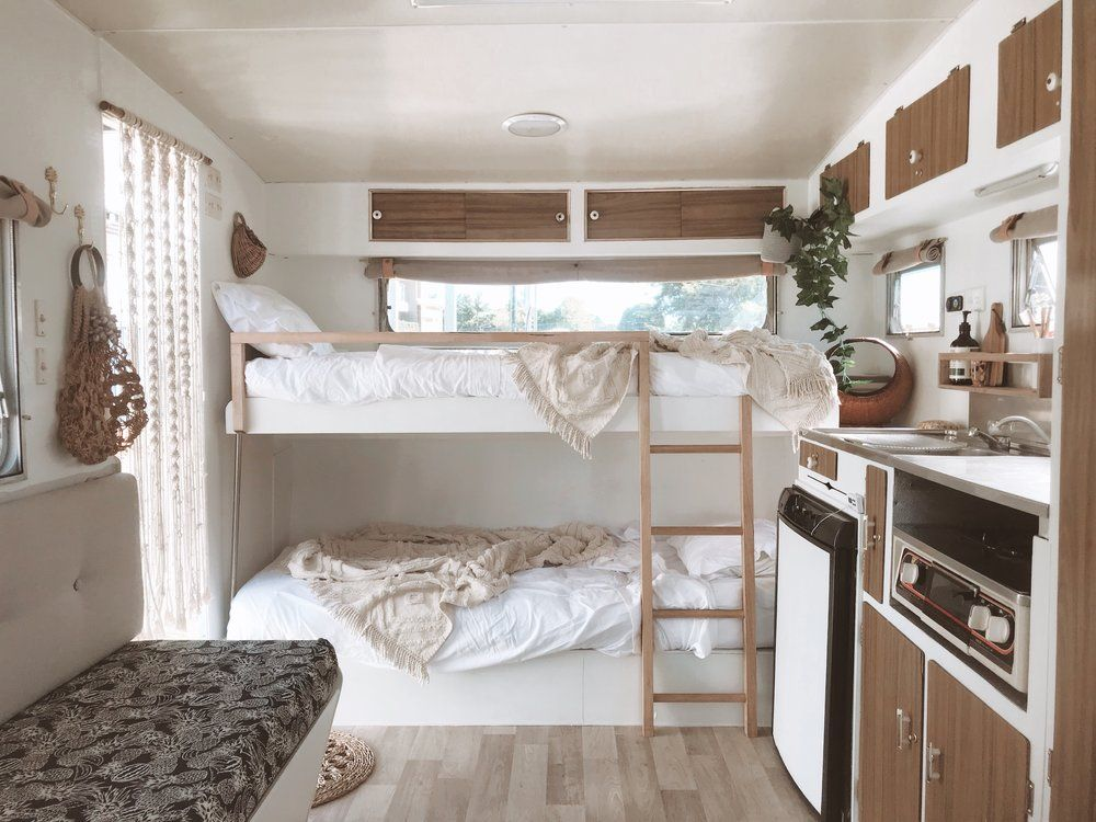 Travel Trailer Remodel Ideas | Need inspiration for bunks in your own travel trailer renovation? We've got lots of travel trailer remodel ideas all in the one place; with clever and cozy beds, and luxurious Rv interiors. #caravanrenovation #vintagecaravan #caravanremodel #traveltrailerrenovation #vintagetrailer #traveltrailerremodel