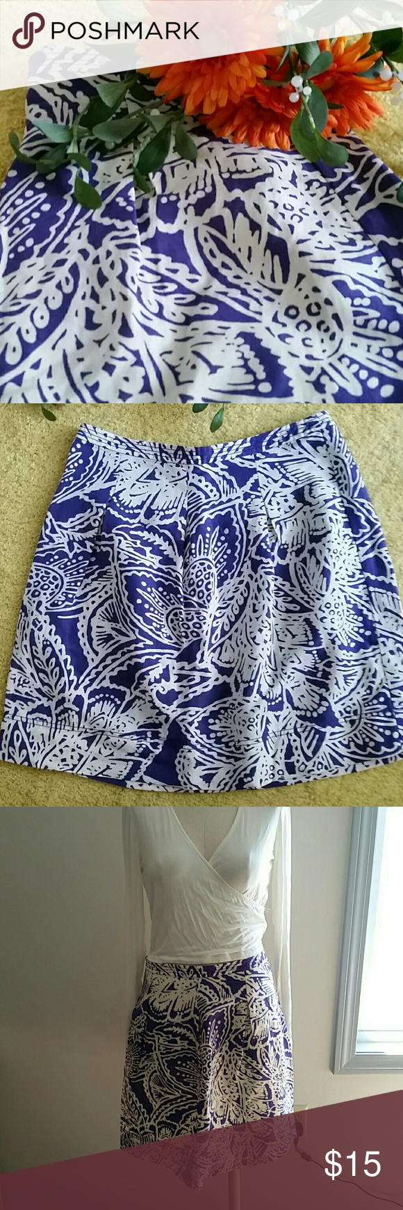 Lovely blue print skirt Just lovely blue cotton skirt from Loft. Measures 20 inches long. Front pleats and back zip closure. Barely used, in great condition. LOFT Skirts
