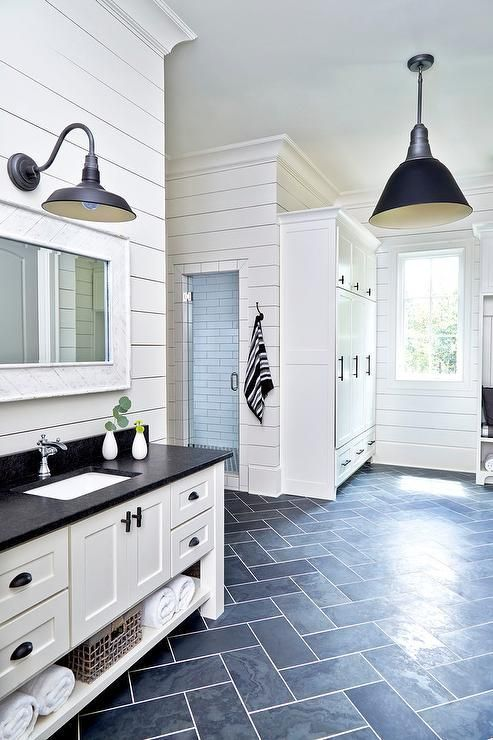 black and white cottage mudroom is clad in dark slate