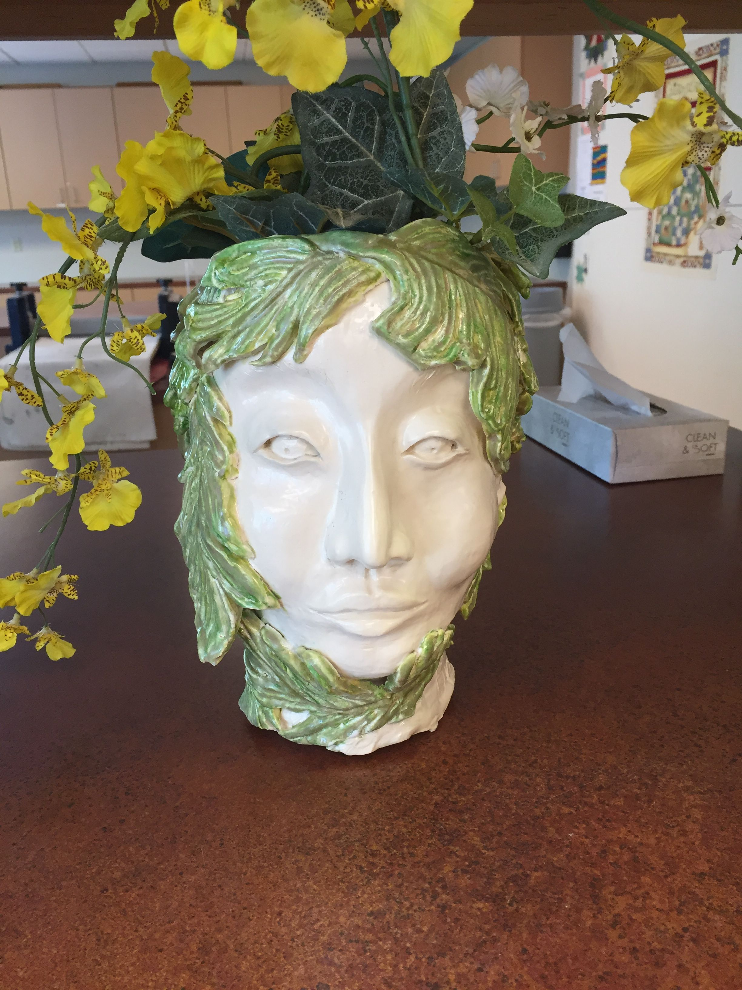 Head planter of clay by Barbara Fronce from Sculpture Class at The Highlands at Dove Mt Marana AZ 2016