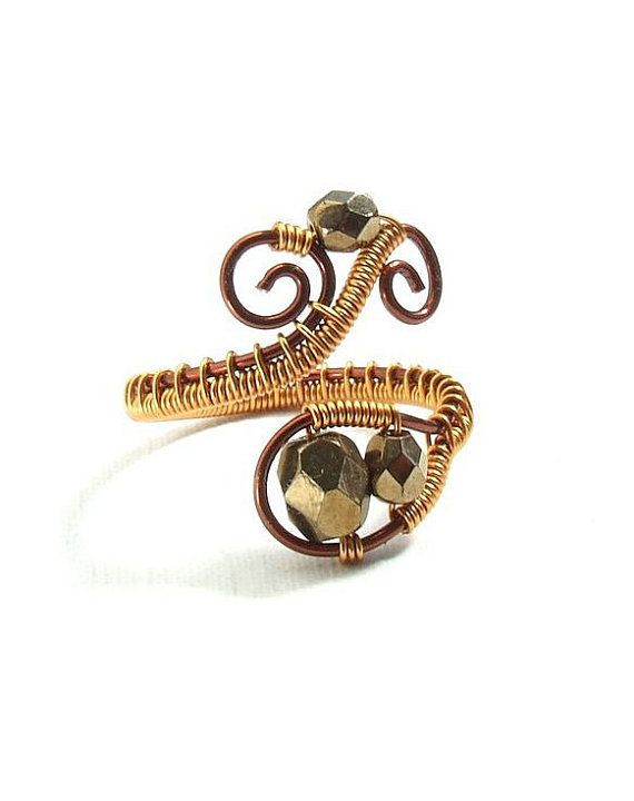 Coiled copper wire and faceted beads give this shapely ring texture ...