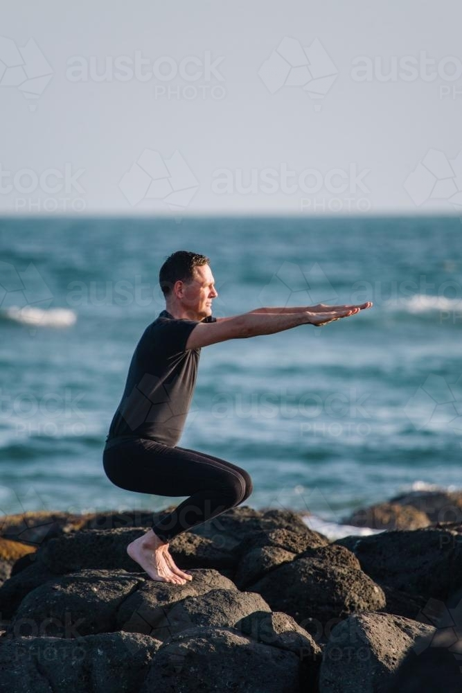 Hipster Guy Practicing Yoga . Young Attractive And Happy