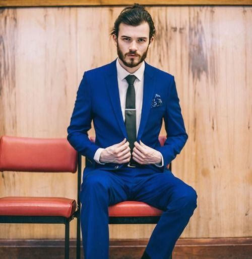 mens blue suit white dress shirt black tie blue floral