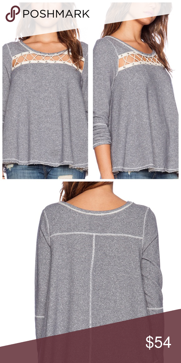 "Free People ""Lacey Love Pullover"" M New with tags Free People ""Lacey Love Pullover"", raw edges & seams, slightly oversized. Chest width cutout with Ivory laced through grommets. Color is ""Indigo Combo"" (blue & white stripes), size Medium Free People Sweaters Crew & Scoop Necks"