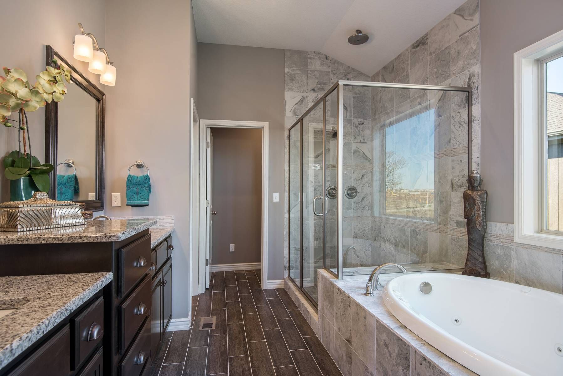 Dark vanity cabinets and cool grey walls