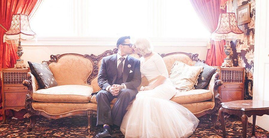 http://blog.cakeknifephotography.com/wp-content/uploads/2014/02/wedding-sanfrancisco-california-groom-queen-anne-hotel-bedroom-photography-photographer-portrait-lighting-professional-bride-san-francisco-hip-fashion-lobby-kiss-pink-love-dress-interior-design-900x464.jpg