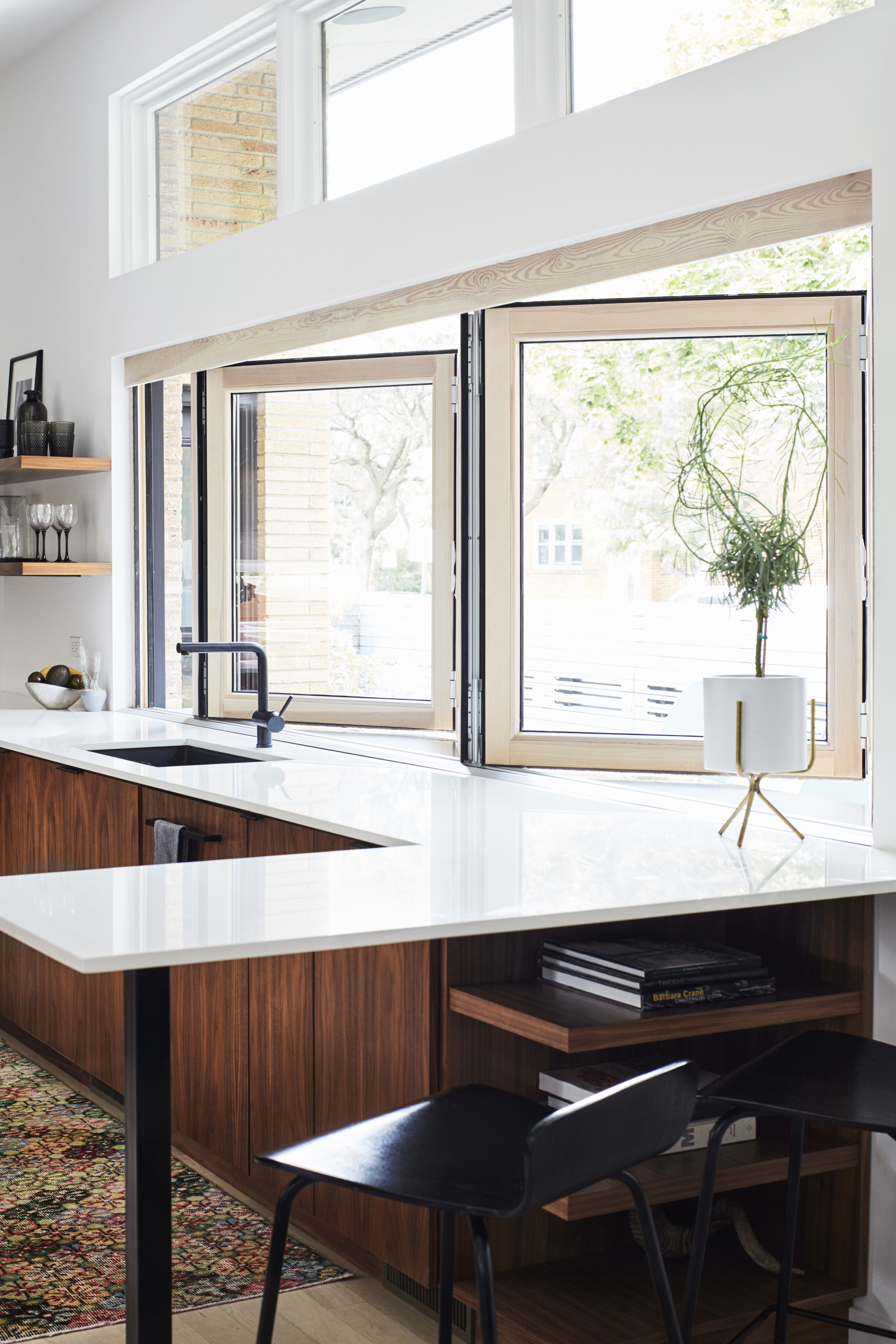 A 14 foot wide opening defines the kitchen which