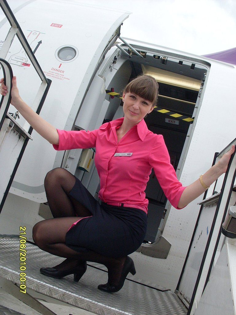 58fcc3a7452cd Sexy flight attendant with black pantyhose and nice uniform. Woman in  pantyhose