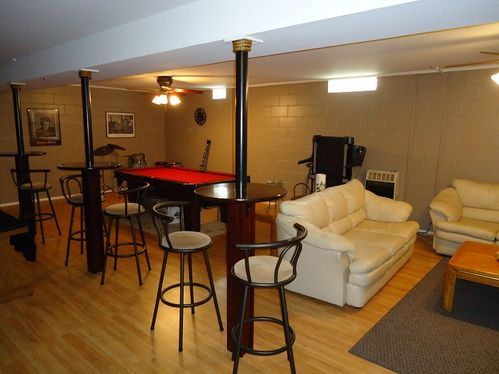 Great Idea On Turning Those Basement Support Poles Into Mini Tables For A Basement Rec Room