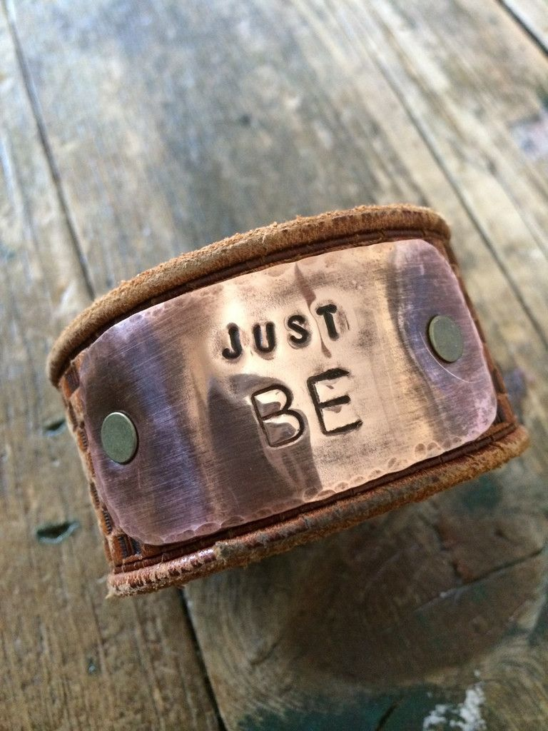"Handcrafted Leather cuff. I have stamped the copper plate with, JUST BE. The leather is from a recycled Leather Belt. This cuff will fit wrists up to 7"" as a wa"