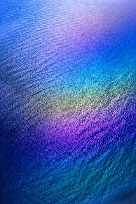 Light reflecting and detracting off the surface of the Pacific Ocean near Hawaii