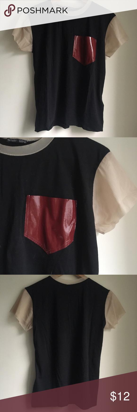 Zara detailed Tee Zara tee with fun details. Mesh like sleeves. Faux patent leather pocket. Never worn Zara Tops Tees - Short Sleeve