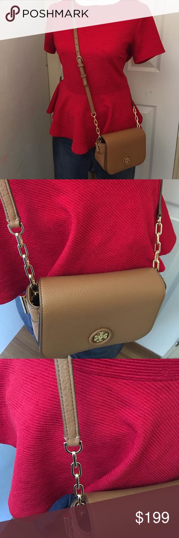 9df2b4813ec3 Tory Burch whipstitch logo mini crossbody bag Brand new crossbody bag. It  fits iPhone 7 plus Tory Burch Bags Crossbody Bags