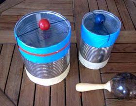 (manualidad niños tambor lata)   El tambor lo hemos hecho con una lata. El hilo es de goma. En el momento que tiras de la perla y la suelt...