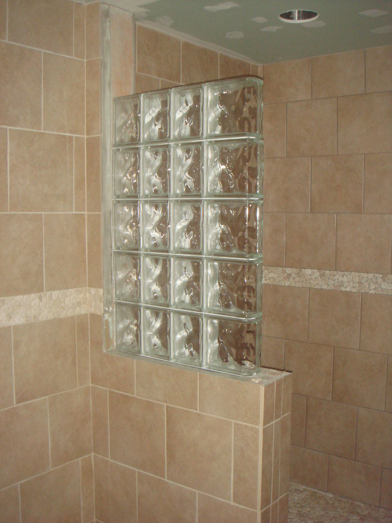 Half wall shower design an addition some glass block wall and much of the grouting is done