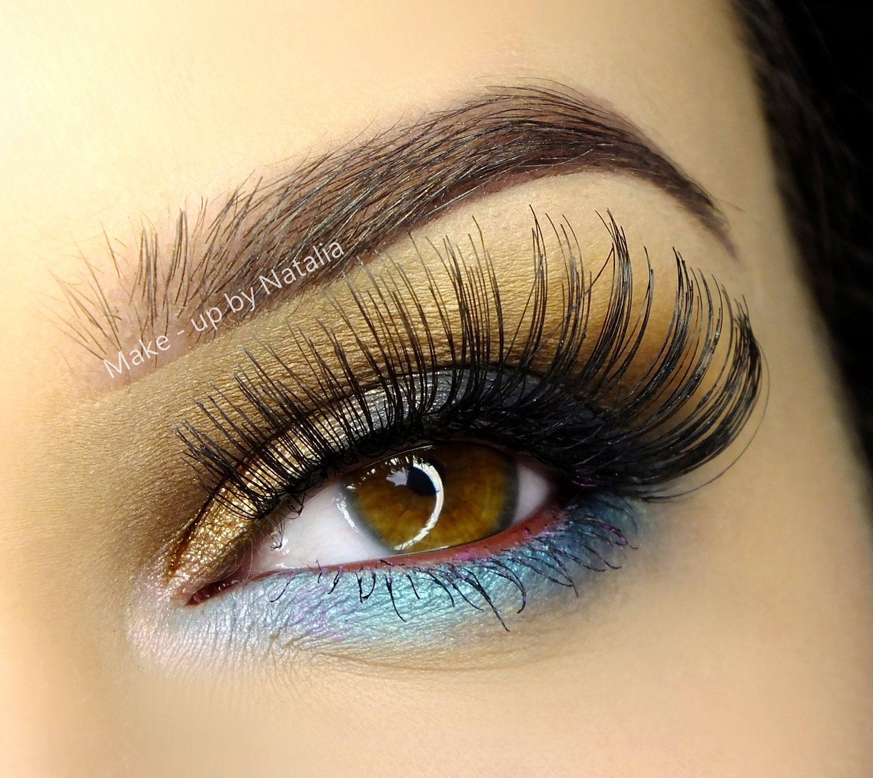 Long lashes accent this glamorous look by Makeupby