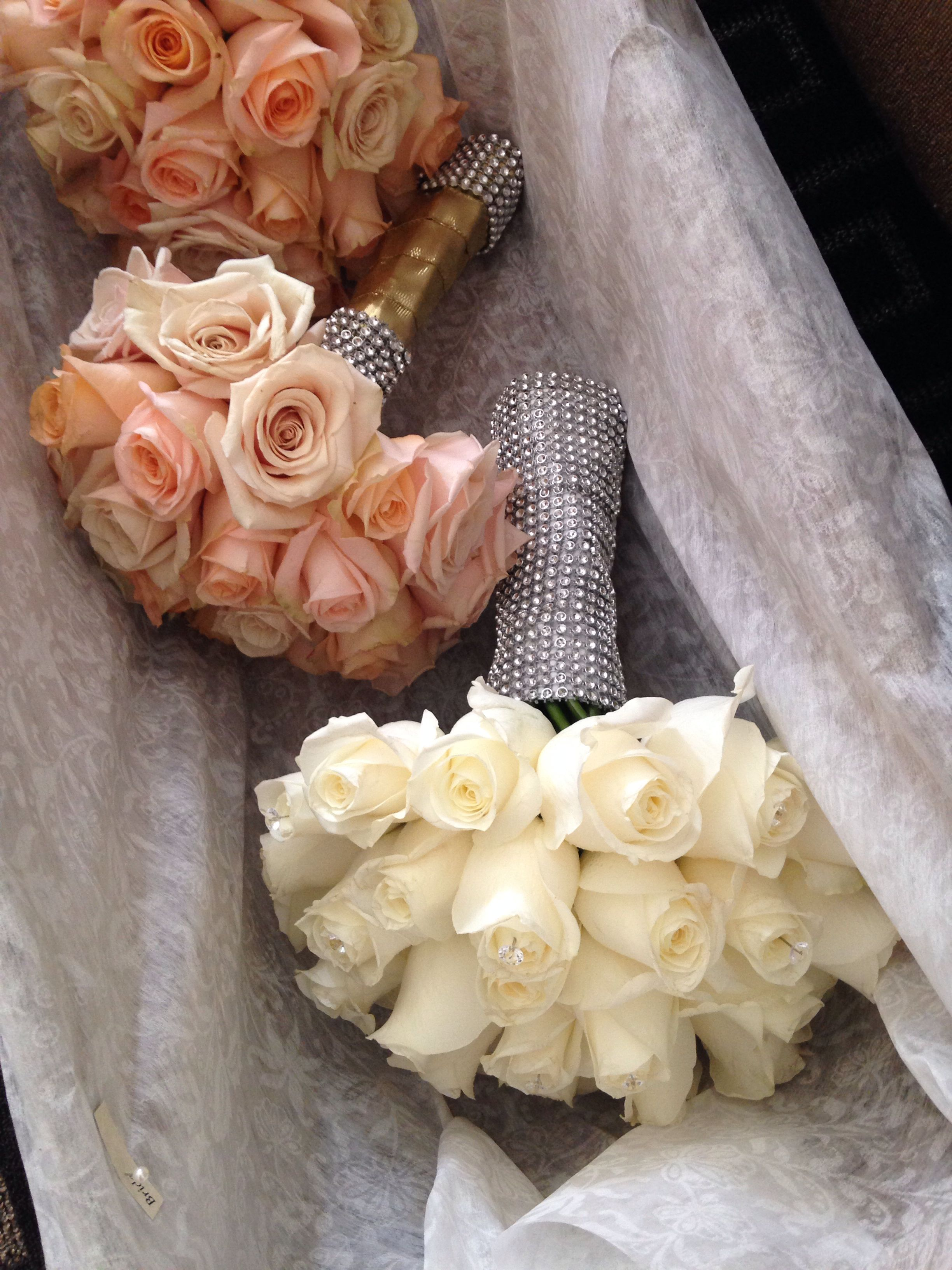 Champagne and pale peach roses. #diamonds #goldwrapping