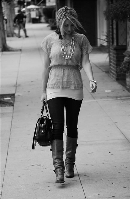 Layering a chiffon blouse over a tank and tights- lovely, esp with the boots and pearls. I would've never thought of it.