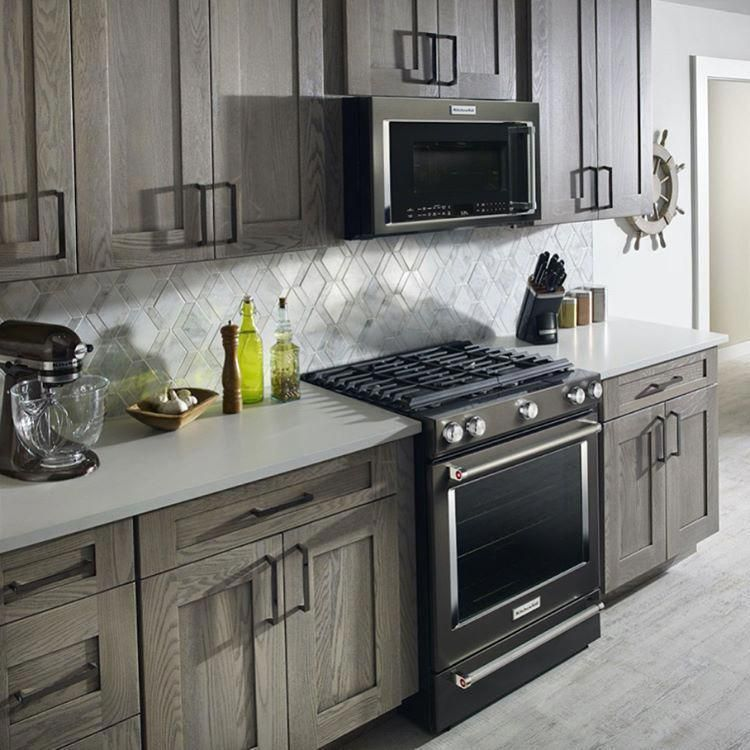 pictures of white kitchens with black stainless steel appliances
