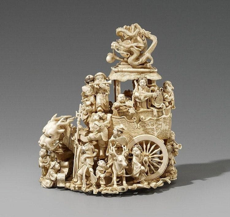 An elaborate ivory okimono of the Seven Gods of Good Luck. Late 19th century An elaborate ivory okimono of the Seven Gods of Good Luck, Okame, Fukusuke and a number of karako, some of them playing music in and around a cart drawn by a dragon-headed horse, with a roof topped by a dragon, the base with takaramo, details inlaid in mother-of-pearl, coral, lacquer and horn. Signed on an inlaid red lacquer tablet