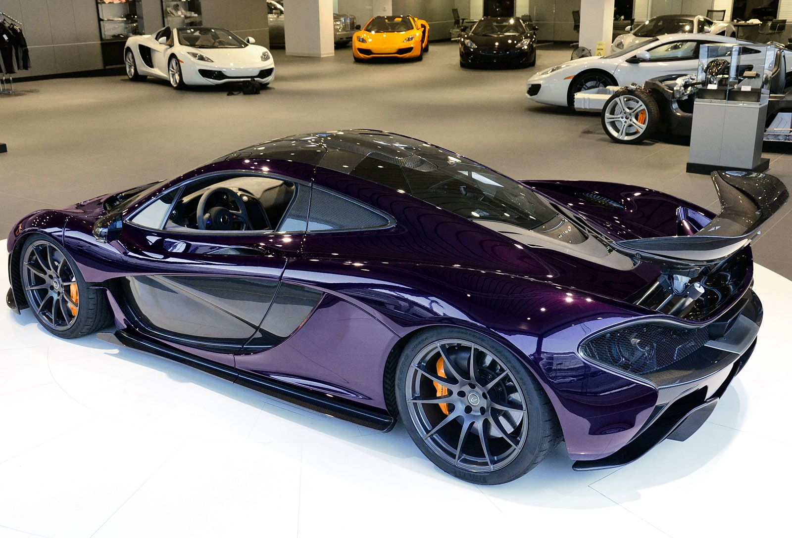 Mclaren P1 In Amethyst Black A Couple Of 12c S In The Background Super Cars Mclaren P1 Cars