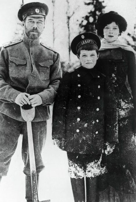 Russian Emperor Nicholas II, left, with son Alexei and daughter Maria. 1916.  British Paintings