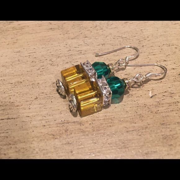 Teal and golden crystal earrings Teal and golden crystal. Hang 1.5 inches from top to bottom. Fun, flirty and sexy. Sterling silver french wires. Jewelry Earrings