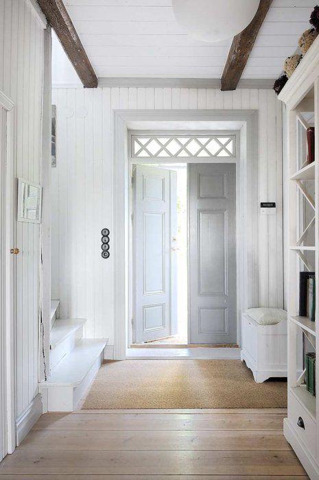 Great entry featuring white walls grey door light floor