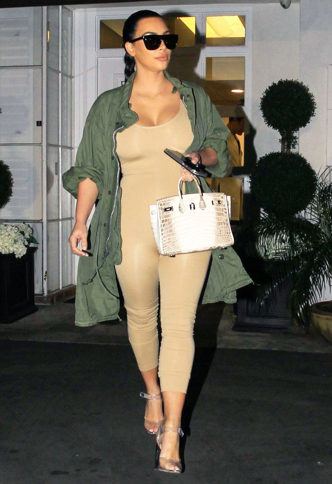 4862bcab183 Kim Kardashian West showed off her post-baby figure in a skin-tight  catsuit
