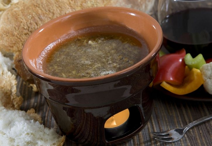 Bagna cauda. A PIemontese classic with olive oil and a ton of garlic and anchovies, for dipping veggies in. Yum!! Photo from barbaragarneaukelley.files.wordpress.com
